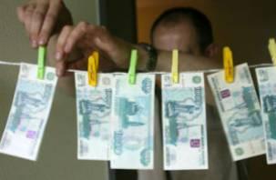 Банда, обвиняемая в сбыте поддельных денег, будет судима