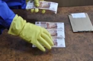 Москвич сбывал на смоленских автозаправках фальшивые деньги