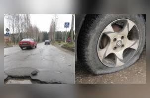 Водители автомобилей оставляют колеса в ярцевских ухабах